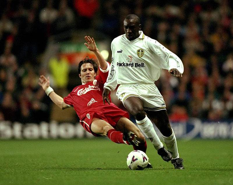 14 Nov 1998:  Jimmy Floyd Hasselbaink of Leeds United is tackled by Oyvind Leonardsen of Liverpool during the FA Carling Premiership match against Liverpool played at Anfield in Liverpool, England.  The match finished in a 1-3 victory for the visitors Leeds United. \ Mandatory Credit: Ben Radford /Allsport