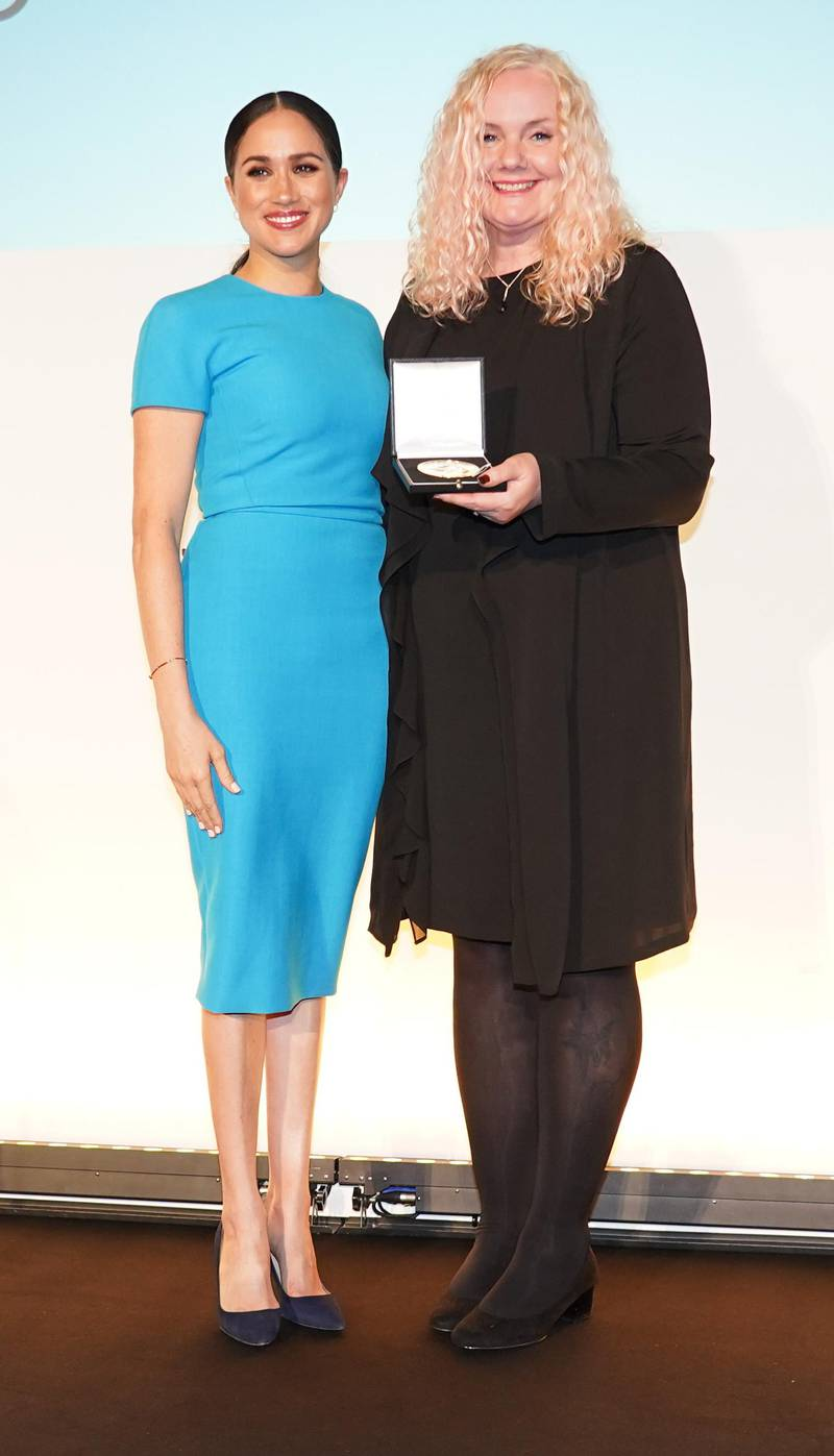LONDON, ENGLAND - MARCH 05: Meghan, Duchess of Sussex presents an award during the annual Endeavour Fund Awards at Mansion House on March 5, 2020 in London, England. Their Royal Highnesses will celebrate the achievements of wounded, injured and sick servicemen and women who have taken part in remarkable sporting and adventure challenges over the last year. (Photo by Paul Edwards - WPA Pool/Getty Images)