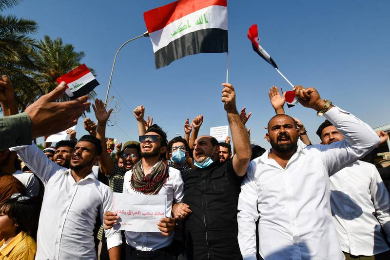 Iraqi demonstrators chant slogans during a gathering in Haboubi Square in the southern city of Nasiriyah on October 28, 2020, to demand a total overhaul of a political system. (Photo by Assaad AL-NIYAZI / AFP)