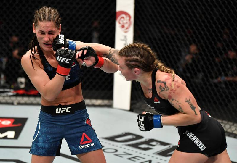 ABU DHABI, UNITED ARAB EMIRATES - JANUARY 23: (R-L) Joanne Calderwood of Scotland punches Jessica Eye in a flyweight fight during the UFC 257 event inside Etihad Arena on UFC Fight Island on January 23, 2021 in Abu Dhabi, United Arab Emirates. (Photo by Jeff Bottari/Zuffa LLC)