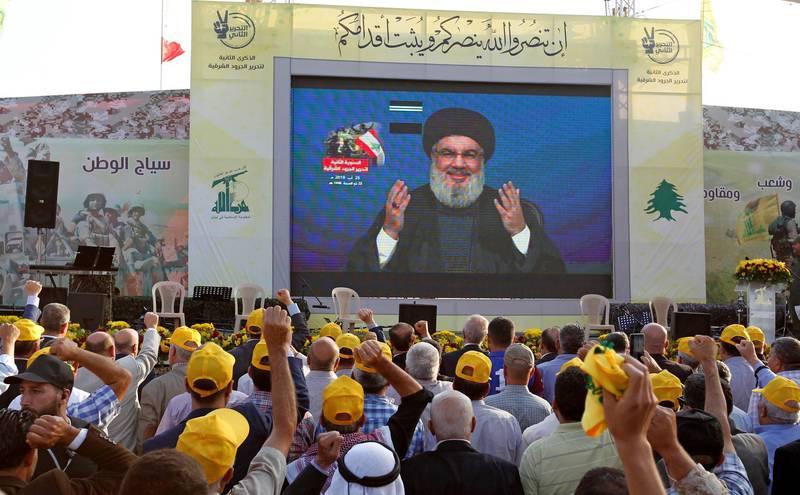 Lebanon's Hezbollah leader Sayyed Hassan Nasrallah gestures as he addresses his supporters via a screen during a rally marking the anniversary of the defeat of militants near the Lebanese-Syrian border, in al-Ain village, Lebanon August 25, 2019. REUTERS/Aziz Taher