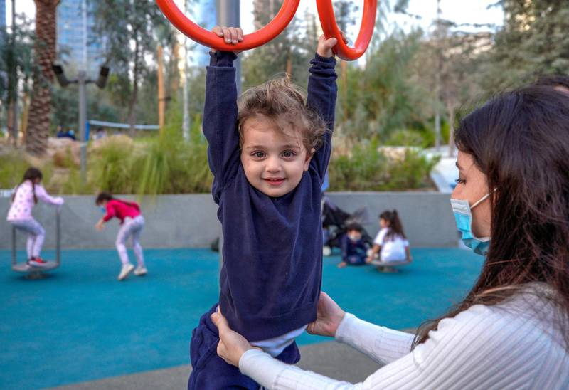 Abu Dhabi, United Arab Emirates, January 21, 2021.  Alex, 2, plays with the rings at Al Fay Park on Reem Island.Victor Besa/The National Section:  LFReporter: Panna Munyal