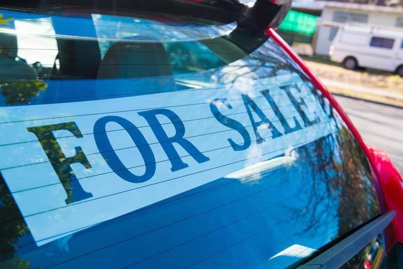 W4B2HR Car For Sale with advertisement sign on the back window. Automotive Industry. Alamy