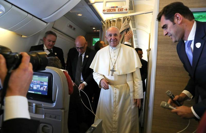 Pope Francis arrives to speak to reporters aboard a plane on the way to Abu Dhabi February 3, 2019. REUTERS/Tony Gentile/Pool