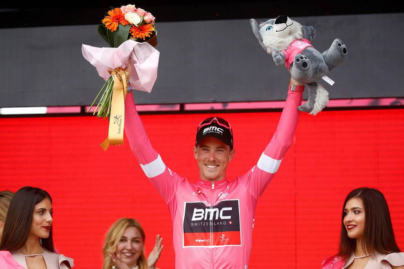 """CORRECTION - Australia's rider of team BMC Rohan Dennis wearing the overall leader's pink jersey celebrates on the podium after the 2nd stage of the 101st Giro d'Italia, Tour of Italy, on May 5, 2018, 167 kilometers between Haifa and Tel Aviv. / AFP PHOTO / Luk Benies / """"The erroneous mention[s] appearing in the metadata of this photo by Luk Benies has been modified in AFP systems in the following manner: [Australia's rider of team BMC Rohan Dennis] instead of [Netherlands' rider of team Sunweb Tom dumoulin]. Please immediately remove the erroneous mention[s] from all your online services and delete it (them) from your servers. If you have been authorized by AFP to distribute it (them) to third parties, please ensure that the same actions are carried out by them. Failure to promptly comply with these instructions will entail liability on your part for any continued or post notification usage. Therefore we thank you very much for all your attention and prompt action. We are sorry for the inconvenience this notification may cause and remain at your disposal for any further information you may require."""""""