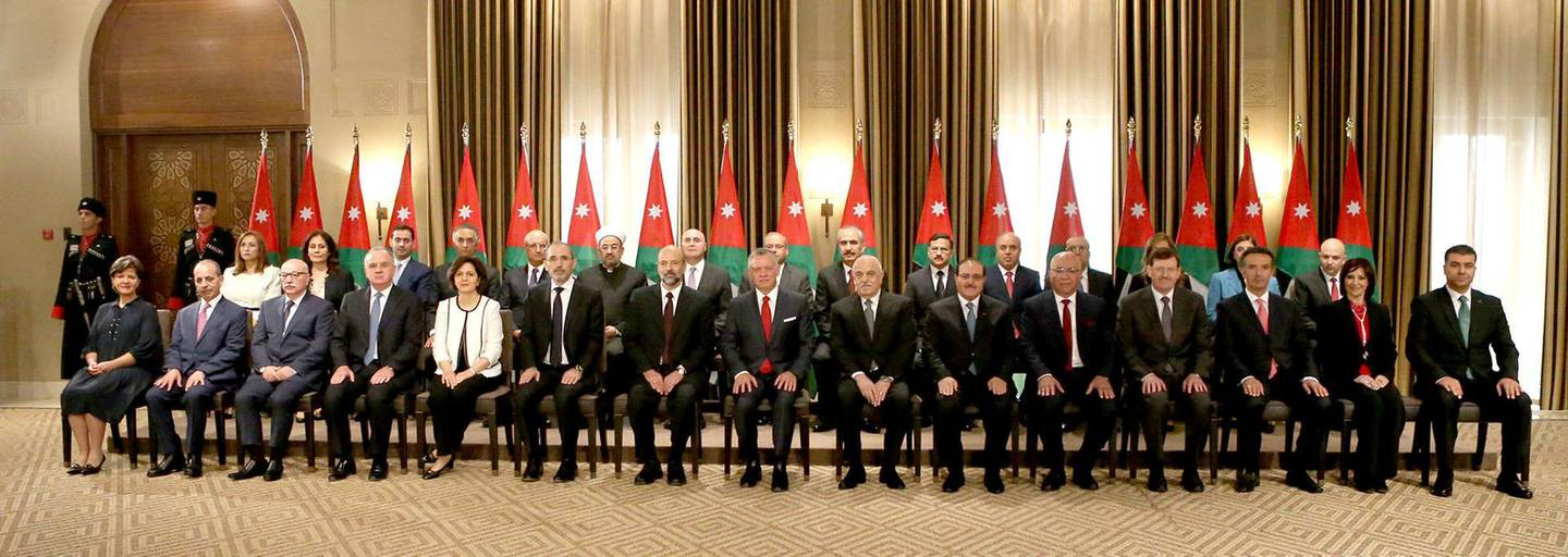 Jordan's King Abdullah II sits as he poses with ministers during a swearing-in ceremony of the new cabinet in Amman, Jordan June 14, 2018. Jordanian Royal Palace/Handout via Reuters ATTENTION EDITORS - THIS IMAGE HAS BEEN SUPPLIED BY A THIRD PARTY. FOR EDITORIAL USE ONLY.