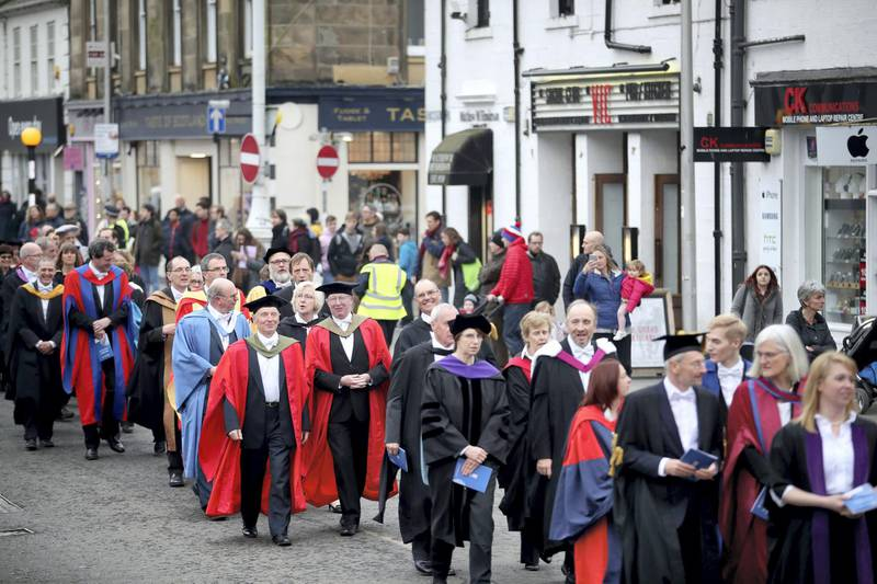 Academics take part in the procession through the streets of St Andrews, Fife, after Serbian political activist Srdja Popovic was installed as the new rector at the University of St Andrews. (Photo by Jane Barlow/PA Images via Getty Images)