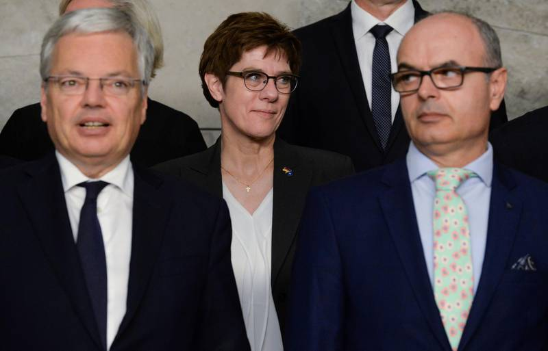 Germany's Defence Minister Annegret Kramp-Karrenbauer and Belgium's Defence Minister Didier Reynders pose for a family photo during the NATO defence ministers meeting at the Alliance headquarters in Brussels, Belgium October 24, 2019. REUTERS/Johanna Geron?