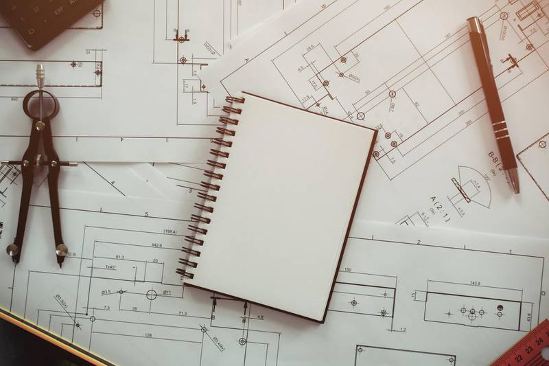 Architecture, engineering plans and drawing equipment for a new building. Getty Images
