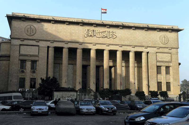 A picture shows Egypt's High Court in downtown Cairo on January 1, 2015, during the hearing of three Al-Jazeera reporters on charges of aiding the Muslim Brotherhood. Egypt's top court ordered a retrial of the three Al-Jazeera reporters whose imprisonment on charges of aiding the Muslim Brotherhood triggered global outrage, but kept them in custody pending a new hearing. Australian Peter Greste, Egyptian-Canadian Mohamed Fahmy and Egyptian Baher Mohamed of the broadcaster's English service were detained in December 2013. AFP PHOTO / KHALED DESOUKI (Photo by KHALED DESOUKI / AFP)