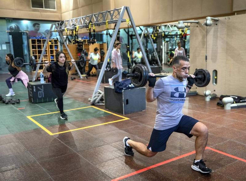 Ihsan Al Sakka does weight training and cardio excercises with his children, Huda, 15 and Nur, 20 at the Abu Dhabi Country Club on June 1st, 2021. Victor Besa / The National.Reporter: Haneen Dajani for News
