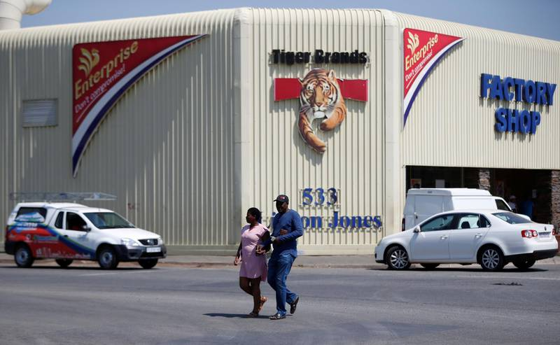 FILE PHOTO: A couple leaves Tiger Brands factory shop in Germiston, Johannesburg, South Africa, March 5, 2018. REUTERS/Siphiwe Sibeko/File Photo