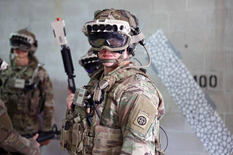 """This handout photo courtesy of US Army taken on October 21, 2020 shows soldiers testing the Capability Set 3 (CS3) militarized form factor prototype of the Army's Integrated Visual Augmentation System (IVAS) and wield a Squad immersive Virtual Trainer (SiVT) during a training environment test event at its third Soldier Touchpoint (STP 3) at Fort Pickett, Virginia. Microsoft has won a massive Pentagon contract for augmented reality headgear for soldiers, the company and the military announced, in a deal reported to be worth more than $20 billion. The headsets, based on commercially available HoloLens, will make soldiers safer and more effective, according to Microsoft technical fellow Alex Kipman.  - RESTRICTED TO EDITORIAL USE - MANDATORY CREDIT """"AFP PHOTO / US ARMY / Courtney BACON"""" - NO MARKETING - NO ADVERTISING CAMPAIGNS - DISTRIBUTED AS A SERVICE TO CLIENTS  / AFP / US ARMY / Courtney BACON / RESTRICTED TO EDITORIAL USE - MANDATORY CREDIT """"AFP PHOTO / US ARMY / Courtney BACON"""" - NO MARKETING - NO ADVERTISING CAMPAIGNS - DISTRIBUTED AS A SERVICE TO CLIENTS"""