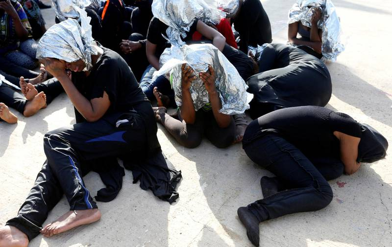 FILE PHOTO: Migrants at a naval base after being rescued by Libyan coast guards in Tripoli, Libya, June 18, 2018.  REUTERS/Ismail Zitouny/File Photo