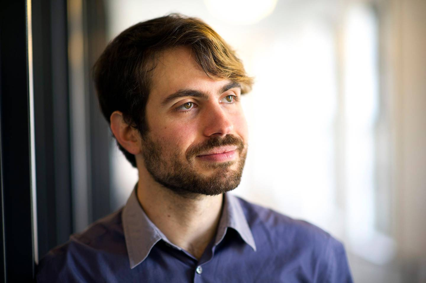 Justin Rosenstein, co-founder and chief executive officer at Asana Inc., stands for a photograph after a Bloomberg West Television interview in San Francisco, California, U.S., on Tuesday, March 26, 2013. Asana Inc. provides a collaboration software that offers a web application that enables users to capture, plan, organize and distribute tasks. Photographer: David Paul Morris/Bloomberg *** Local Caption *** Justin Rosenstein