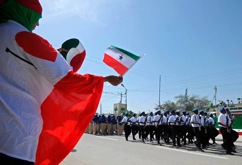 (FILES) This file photo taken on May 18, 2016 shows a woman waving a flag as soldiers and other military personnel of Somalia's breakaway territory of Somaliland march past during an Independence day celebration parade in the capital, Hargeisa.   The self-proclaimed state of Somaliland will vote for a new president on November 13, 2017, hoping to continue a series of democratic transitions of power that sets it apart from its troubled neighbour Somalia. The northern territory, which is more tribally homogenous and stable than the rest of Somalia, broke away in 1991 and has been striving to attain international recognition ever since.  / AFP PHOTO / MOHAMED ABDIWAHAB