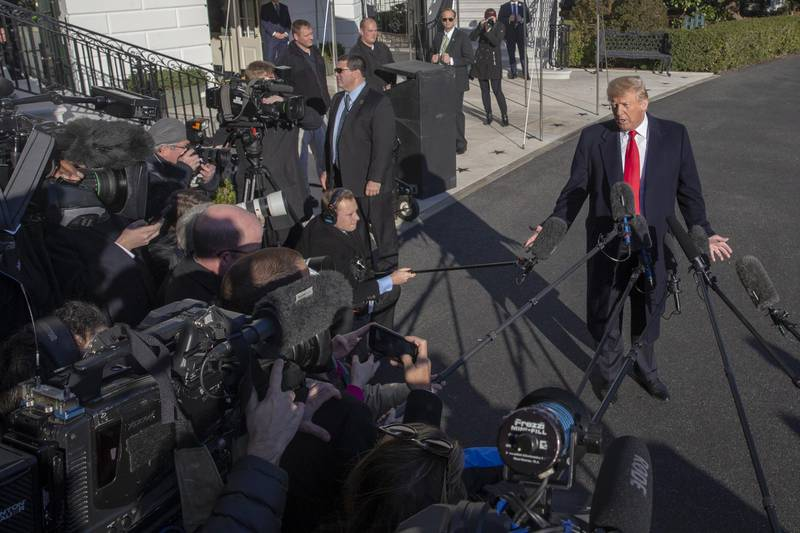 U.S. President Donald Trump speaks to members of the media on the South Lawn of the White House after arriving on Marine One in Washington, D.C., U.S., on Sunday, Jan. 6, 2019. Trumpedged closer toward a radical move to fund his border wall after the prospect of a deal with the Democrats to re-open government dimmed and the president's political leverage appeared to dissipate. Photographer: Tasos Katopodis/Bloomberg