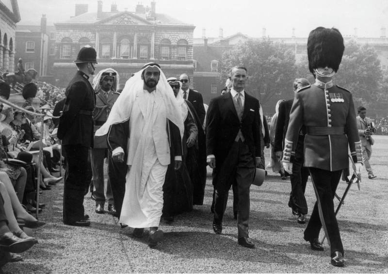 Sheik Khalifa bin Zayed Al Nahyan, President of the United Arab Emirates, in white, being escorted to his seat in Horse Guards Parade, London during the Trooping of the Colour Ceremony on June 14, 1969. (AP Photo/Str)