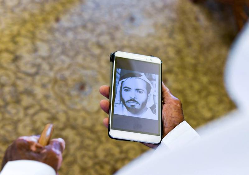 Abu Dhabi, United Arab Emirates - Buti Al Mazrouei, 80, shows a photograph of himself during his younger days, at his home in Al Ain. Khushnum Bhandari for The National