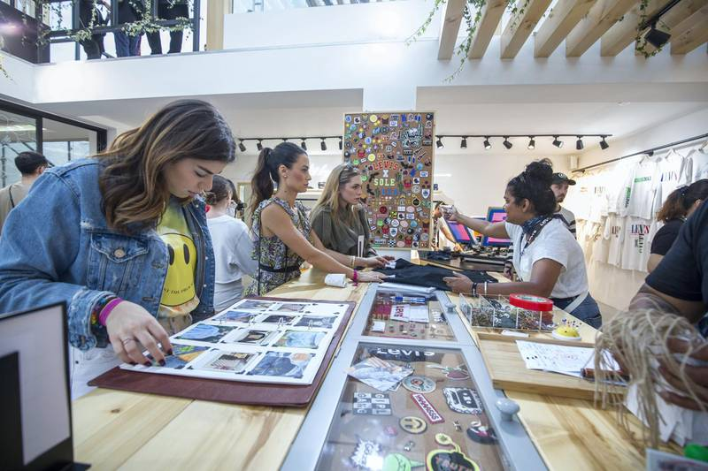 Dubai, United Arab Emirates-  Visitors checking out art design in one of the brand outlet at the Sole Dubai Festival at D3.  Leslie Pableo for The National for Saeed Saeed's story