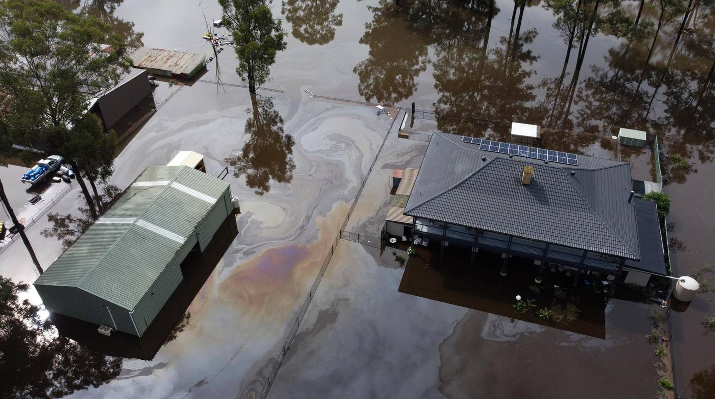 In this drone photo a property is surrounded by flood waters in Londonderry on the outskirts of Sydney, Australia, Tuesday, March 23, 2021. Hundreds of people have been rescued from floodwaters that have isolated dozens of towns in Australia's most populous state of New South Wales and forced thousands to evacuate their homes as record rain continues to inundate the countries east coast. (AP Photo/Mark Baker)
