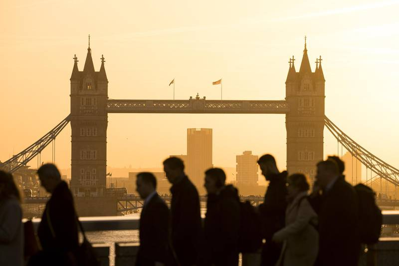 Morning commuters walk across London Bridge in view of Tower Bridge in London, U.K., on Monday, Feb. 3, 2020. London is still 'where ithappens' for European finance, William Russell, the Lord Mayor of London says. Photographer: Jason Alden/Bloomberg