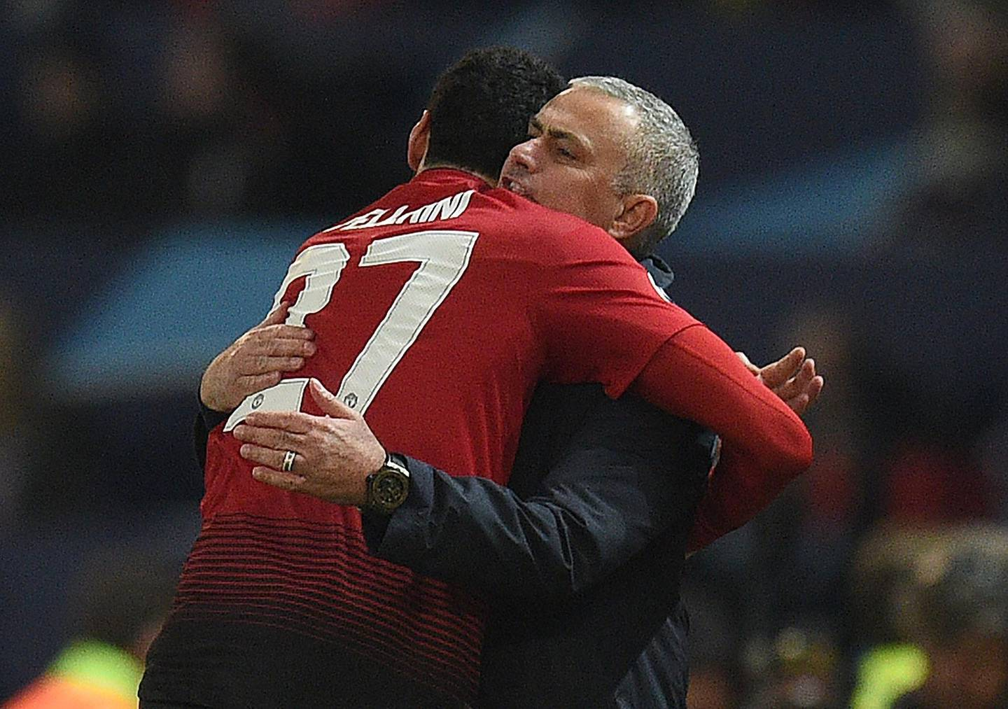 Manchester United's Belgian midfielder Marouane Fellaini (L) celebrates scoring the opening goal with Manchester United's Portuguese manager Jose Mourinho during the UEFA Champions League group H football match between Manchester United and Young Boys at Old Trafford in Manchester, north-west England on November 27, 2018.  / AFP / Oli SCARFF