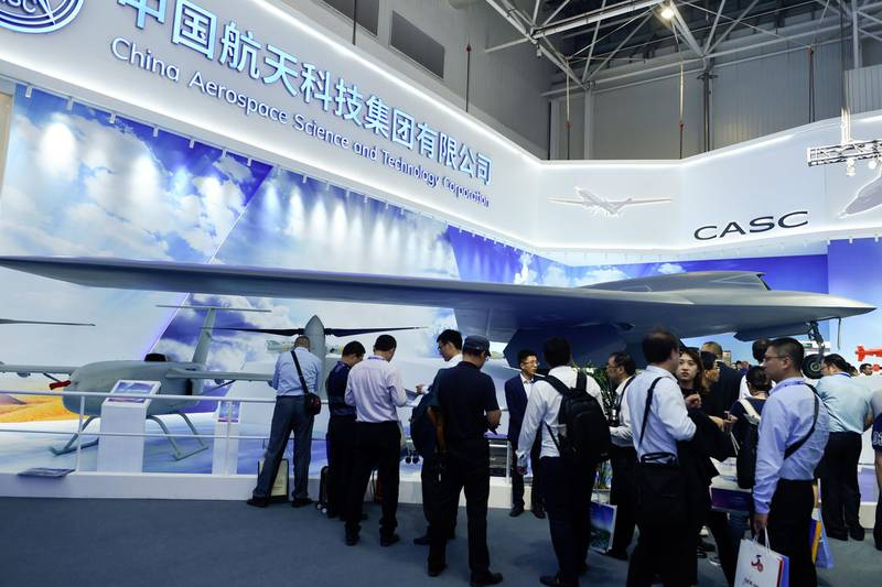 (FILES) In this file photo taken on November 6, 2018, a model of CH-7 HALE Stealth Unmanned Reconnaissance Aircraft is seen on display at the Airshow China 2018 in Zhuhai, south China's Guangdong province. China is unleashing stealth drones and pilotless aircraft fitted with AK-47 rifles onto world markets, racing to catch up to US technology and adding to a fleet that has seen combat action in the Middle East. / AFP / WANG Zhao / TO GO WITH China-US-weaponry-aerospace, FOCUS by Ludovic EHRET