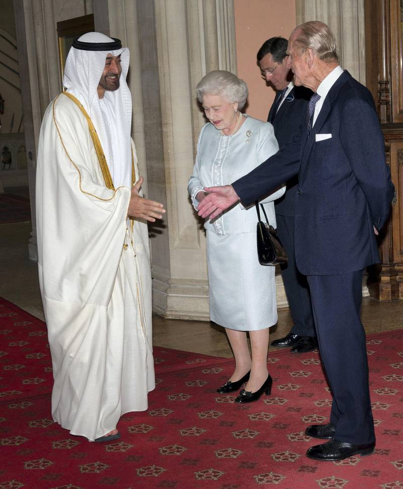 WINDSOR, ENGLAND - MAY 18: Queen Elizabeth II and Prince Philip, Duke of Edinburgh greet  The Crown Prince of Abu Dhabi, Sheikh Mohammed bin Zayed Al Nahyan as he arrives at a lunch for Sovereign Monarch's held in honour of Queen Elizabeth II's Diamond Jubilee, at Windsor Castle, on May 18, 2012 in Windsor, England. (Photo by Arthur Edwards - WPA Pool/Getty Images)