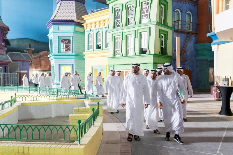 Yas Island, ABU DHABI, UNITED ARAB EMIRATES - March 1, 2018: HH Sheikh Mohamed bin Zayed Al Nahyan, Crown Prince of Abu Dhabi and Deputy Supreme Commander of the UAE Armed Forces (L), inspects the Construction  site of Warner Bros Abu Dhabi. Seen with HE Mohamed Khalifa Al Mubarak, Chairman of the Department of Culture and Tourism and Abu Dhabi Executive Council Member (R).  ( Rashed Al Mansoori / Crown Prince Court - Abu Dhabi ) ---