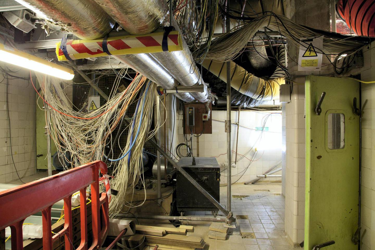 """A handout picture released by the UK Parliament on January 30, 2018 and taken on April 24, 2014 shows one of the 100 plant rooms in the basement of the Palace of Westminster in London.    British lawmakers were set to deabte the proposed restoration of the Palace of Westminster, the historic palace that houses the UK Houses of Parliament. A parliamentary report published in 2016 recommended that lawmakers should move out of the crumbling building while it is renovated to avert a crisis. Behind its neo-Gothic facades topped by the world-famous Big Ben clock tower, the mother of parliaments has been eroded by air pollution, overrun with mice and crumbling, prompting warnings it may have to be permanently abandoned unless urgent renovations are carried out costing billions of pounds.  / AFP PHOTO / UK PARLIAMENT / HO / RESTRICTED TO EDITORIAL USE - MANDATORY CREDIT  """" AFP PHOTO / UK PARLIAMENT """"  -  NO MARKETING NO ADVERTISING CAMPAIGNS   -   DISTRIBUTED AS A SERVICE TO CLIENTS SPECIFICALLY TO ILLUSTRATE THE AFP STORY BY JOE JACKSON DATED JAN 31, 2018 -  NO ARCHIVE - RESTRICTED TO SUBSCRIPTION USE - NO SALES - NO USE ON ANY SOCIAL MEDIA PLATFORM - NOT TO BE ADAPTED ALTERED OR MANIPULATED  / TO GO WITH AFP STORY BY JOE JACKSON"""