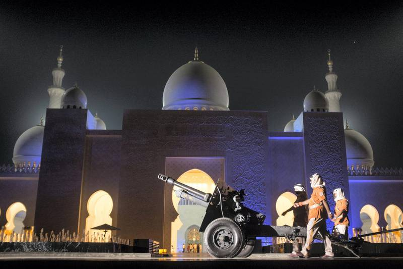 ABU DHABI, UNITED ARAB EMIRATES, JUNE 16, 2015. A practice march in front of the cannon installed at Sheikh Zayed Grand Mosque. Everyday of the month of Ramadan, the cannon is fired to signal the time for Maghreb. Photographer: Reem Mohammed / The National *** Local Caption ***  RM_20160616_ZAYED_014.JPG