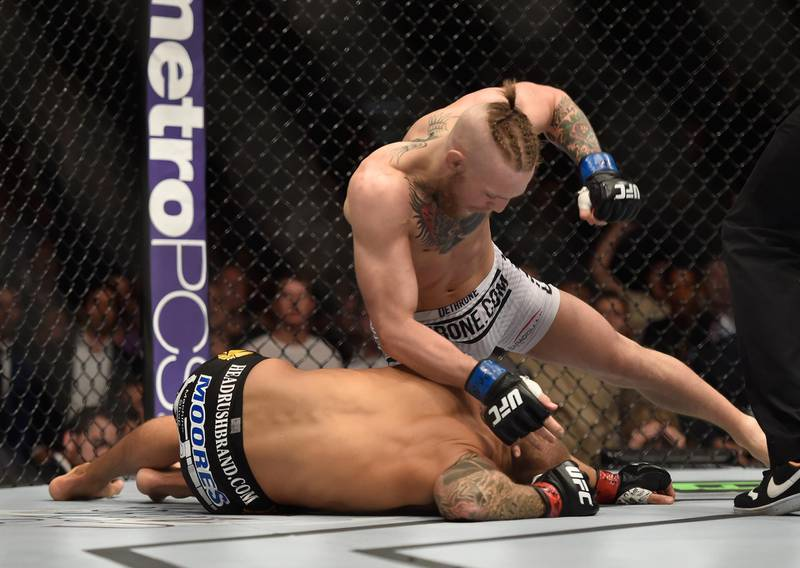 LAS VEGAS, NV - SEPTEMBER 27:  (Top) Conor McGregor punches Dustin Poirier in their featherweight fight during the UFC 178 event inside the MGM Grand Garden Arena on September 27, 2014 in Las Vegas, Nevada.  (Photo by Jeff Bottari/Zuffa LLC/Zuffa LLC via Getty Images)
