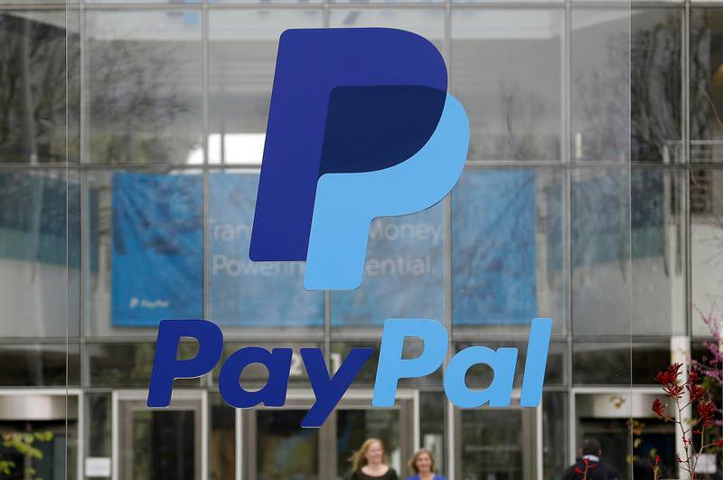 FILE - This March 10, 2015, file photo, shows signage outside PayPal headquarters in San Jose, Calif. PayPal Holdings, Inc. reports earnings Wednesday, July 26, 2017. (AP Photo/Jeff Chiu, File)