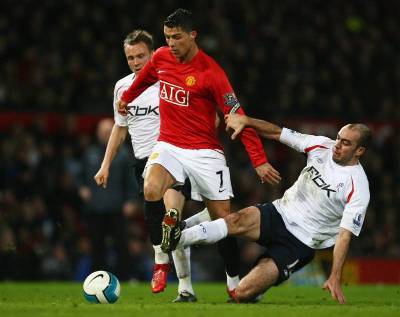 MANCHESTER, UNITED KINGDOM - MARCH 19:  Cristiano Ronaldo of Manchester United takes on Matt Taylor (L) and Gavin McCann of Bolton Wanderers during the Barclays Premier League match between Manchester United and Bolton Wanderers at Old Trafford on March 19, 2008 in Manchester, England.  (Photo by Alex Livesey/Getty Images)