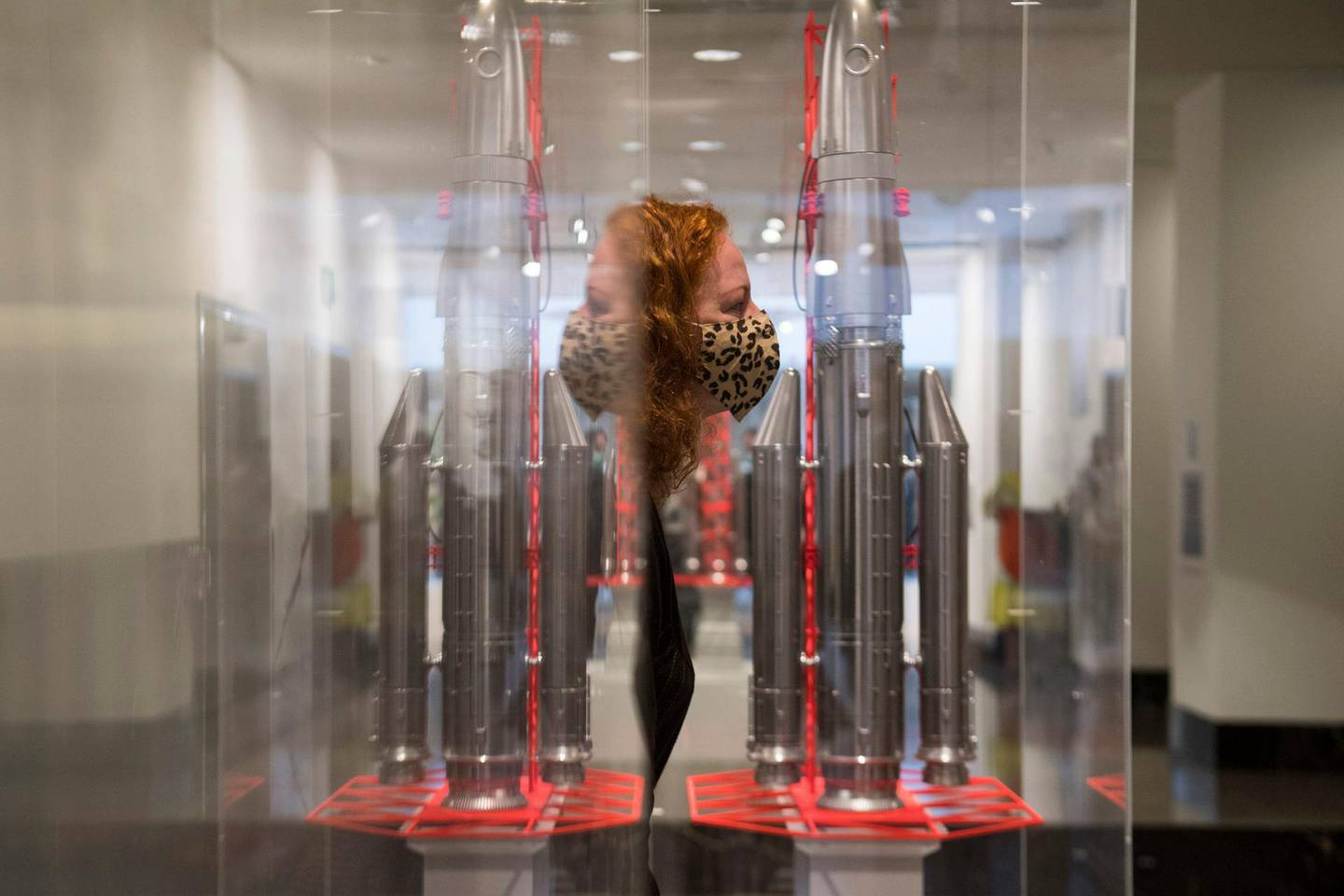 A gallery assistant walks past Gonogo by Goshka Macuga,  on display at the National Gallery, in London, one of the six artworks proposed as the next design for the Fourth Plinth at Trafalgar Square, in London, Monday May 24, 2021. (Kirsty O'Connor/PA via AP)