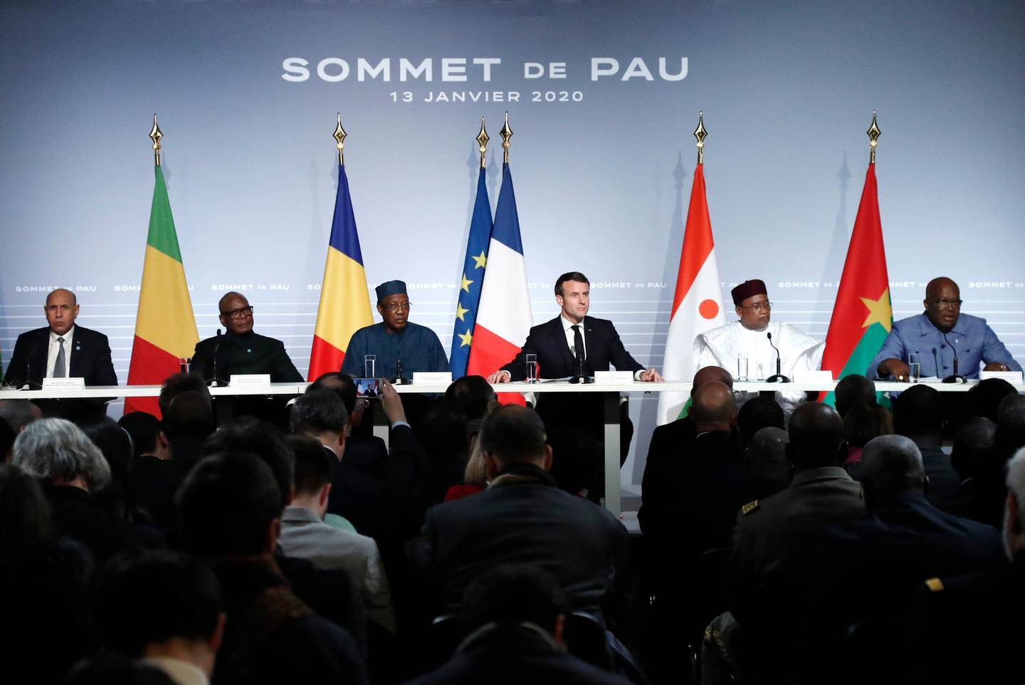 French President Emmanuel Macron, Third right, flanked by Mali's President Ibrahim Boubacar Keita, second left, Burkina Faso's President Roch Marc Christian Kabore, right, Niger President Mahamadou Issoufou second right, Mauritania's President Mohamed Ould Cheikh El Ghazouani, left, and Chad's President Idriss Deby, third right, attend a press conference following the G5 Sahel summit in Pau, southwestern France, Monday Jan.13, 2020. France is preparing its military to better target Islamic extremists in a West African region that has seen a surge of deadly violence. (Guillaume Horcajuelo/Pool Photo via AP)