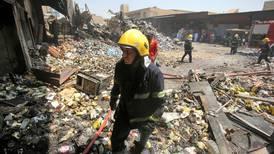 Explosion in Iraq near Shiite mosque kills 3, wounds dozens