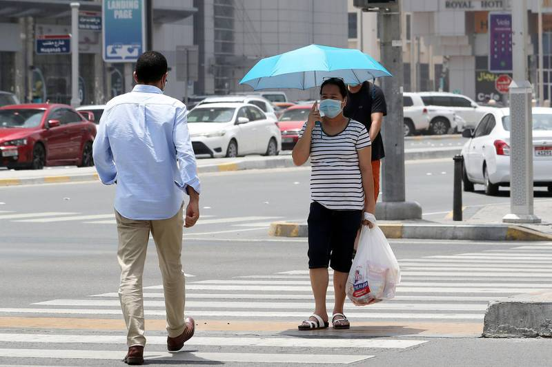 ABU DHABI, UNITED ARAB EMIRATES , June 1 – 2020 :- People wearing protective face mask as a preventive measure against the spread of coronavirus  walking on the streets of Abu Dhabi. UAE government lifts the coronavirus restriction for the residents and businesses around the country. (Pawan Singh / The National) For News/Stock