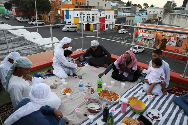 A Muslim family breaks their fast with the Iftar meal during the holy month of Ramadan in the historic Bo-Kaap district in Cape Town, South Africa, May 22, 2020. REUTERS/Sumaya Hisham