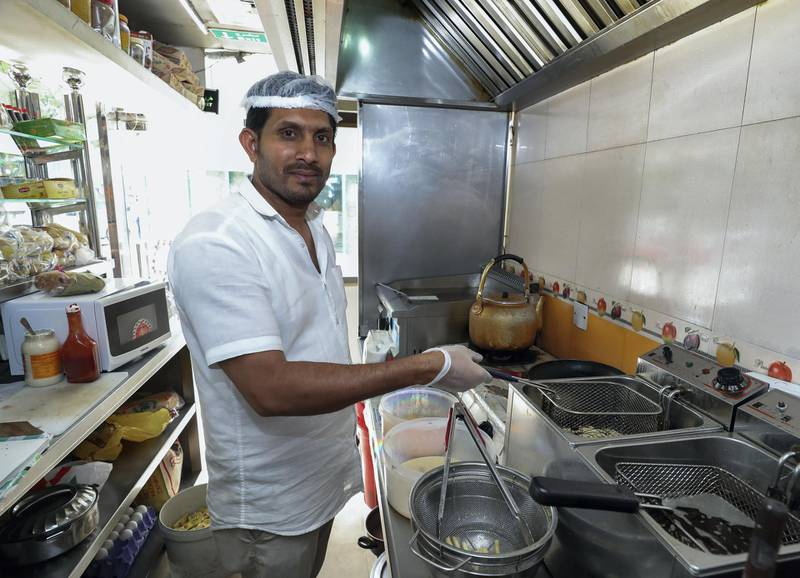Abu Dhabi, UAE, April 2, 2018.   Desert Burger Cafeteria.  French fries being deep fried in the restaurant.  Owner, Abdul Rahim in his kitchen.Victor Besa / The NationalNationalReporter:  Ann Marie McQueen