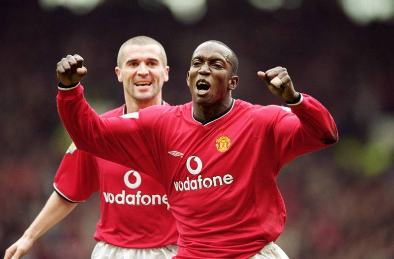 14 Apr 2001:  Manchester United goal scorer Dwight Yorke is congratulated by team mate Roy Keane during the FA Carling Premiership match against Coventry City at Old Trafford in Manchester, England. United won 4-2. \ Mandatory Credit: Clive Brunskill /Allsport / Getty Images
