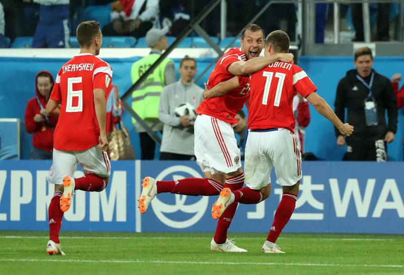 Soccer Football - World Cup - Group A - Russia vs Egypt - Saint Petersburg Stadium, Saint Petersburg, Russia - June 19, 2018   Russia's Roman Zobnin celebrates with Artem Dzyuba and Denis Cheryshev after Egypt's Ahmed Fathy scored an own goal and the first goal for Russia      REUTERS/Pilar Olivares