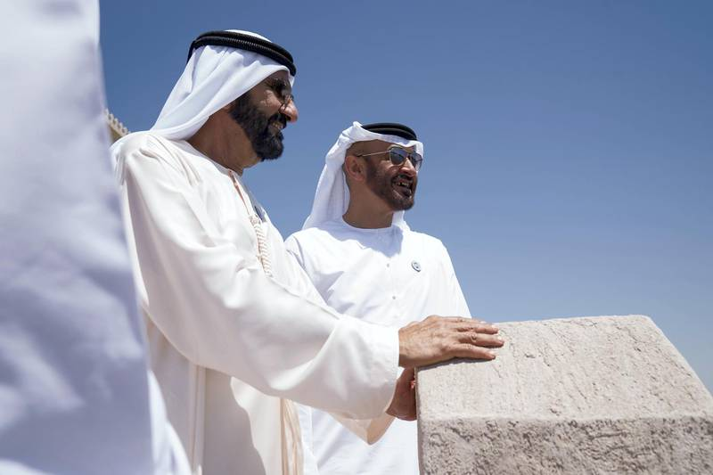 DUBAI, UNITED ARAB EMIRATES - March 20, 2018: HH Sheikh Mohamed bin Zayed Al Nahyan Crown Prince of Abu Dhabi Deputy Supreme Commander of the UAE Armed Forces (L), stands with HH Sheikh Mohamed bin Rashid Al Maktoum, Vice-President, Prime Minister of the  UAE, Ruler of Dubai and Minister of Defence (R), after witnessing the signing of a joint venture agreement between Aldar and Emaar, in Shindagha Heritage District.   ( Mohamed Al Hammadi / Crown Prince Court - Abu Dhabi ) ---