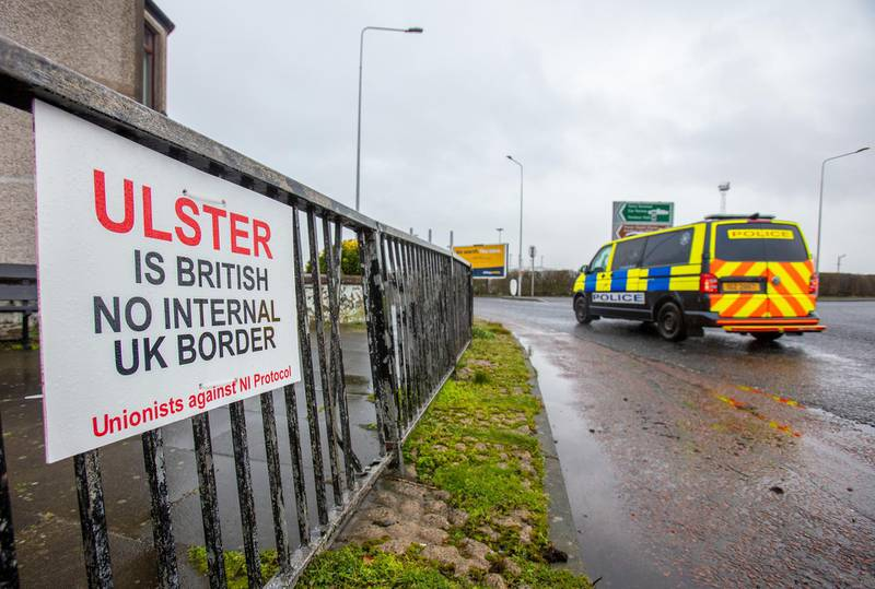 """A placard reads """"Ulster is British, No internal U.K. border"""" near the Port of Larne in Larne, U.K., on Thursday, Feb. 4, 2021. On Tuesday, U.K. Cabinet Office MinisterMichael Gove condemned the EU's threat to impose border checks on Northern Ireland, warning it had provoked anger on all sides of the political divide. Photographer: Paul Faith/Bloomberg"""