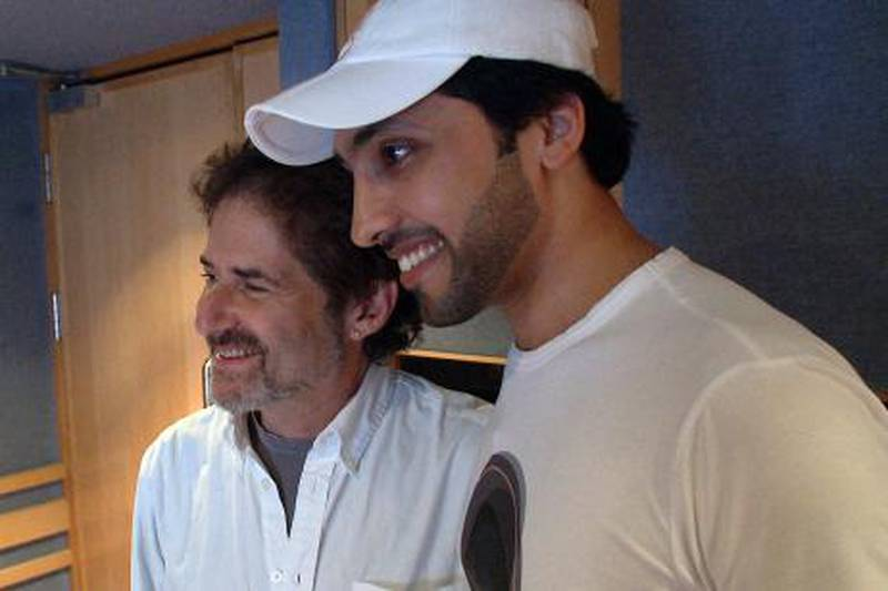 (Left to Right) James Horner with Fahad Al Kubaisi during the recording at Abbey Road Studios in London. Photo Courtesy Seven Media