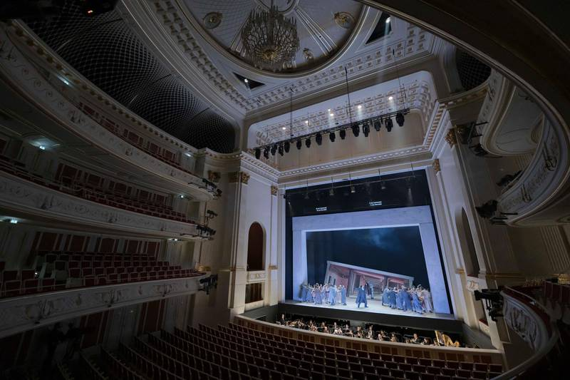 The orchestra and the ensemble of the Staatsoper perform the opera Carmen without audience in the Staatsoper Unter den Linden in Berlin, Germany, Thursday, March 12, 2020. All theatres in the German capital closed because of the coronavirus outbreak in Germany and Europe. The Staatsoper perfome without audience only for a free video stream. For most people, the new coronavirus causes only mild or moderate symptoms, such as fever and cough. For some, especially older adults and people with existing health problems, it can cause more severe illness, including pneumonia. (Staatsoper Berlin/Peter Adamik via AP)