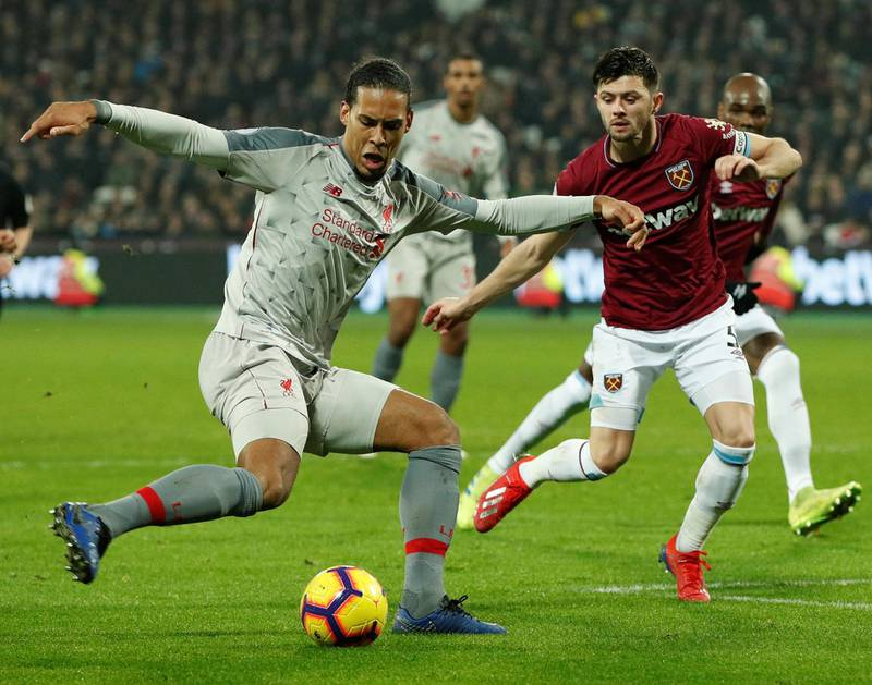 """Soccer Football - Premier League - West Ham United v Liverpool - London Stadium, London, Britain - February 4, 2019  Liverpool's Virgil van Dijk in action with West Ham's Aaron Cresswell               Action Images via Reuters/John Sibley  EDITORIAL USE ONLY. No use with unauthorized audio, video, data, fixture lists, club/league logos or """"live"""" services. Online in-match use limited to 75 images, no video emulation. No use in betting, games or single club/league/player publications.  Please contact your account representative for further details."""