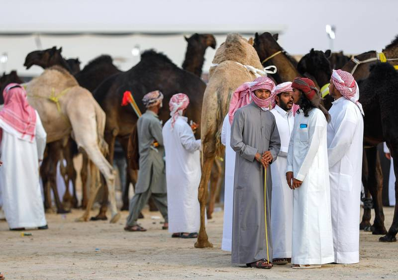 Abu Dhabi, United Arab Emirates, December 11,2019.    -- Visitors and participants at the Al Dhafra Camel Festival 2019.Victor Besa/The NationalSection:  NAReporter:  Anna Zacharias